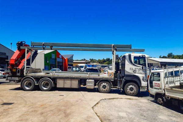elevate_crane_truck_services_steel_beam_haulage